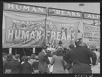 """Outside a freak show at the Rutland Fair in Vermont."" Photograph by Jack Delano.  From the Library of Congress Prints & Photographs Division Washington, DC."