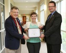 Receiving the Dean's Distinguished Essay Award for my article in Scientia and Humanitas