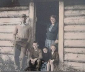 Great Grandma Greta and her family at their cabin in Alaska.